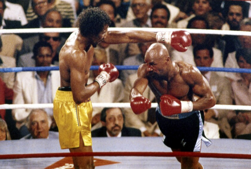 """FILE - In this April 1985 file photo, Marvin Hagler, right, and Thomas Hearns fight during the first round of a world championship boxing bout in Las Vegas. Sugar Ray Leonard, Roberto Duran, Thomas Hearns and Marvelous Marvin Hagler delivered when it mattered, and two of the fights are considered to be among the greatest ever. A four-hour documentary, """"The Kings"""" explores the magical decade. (AP Photo, File)"""