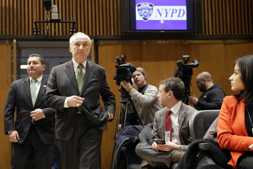 New York Police Commissioner William Bratton, second from left, and Diego Rodriguez, assistant director in charge of the FBI's New York field office, arrive for a news conference at police headquarters, Wednesday, Feb. 25, 2015, in New York, regarding three men who were arrested on charges of plotting to travel to Syria to join the Islamic State group and wage war against the U.S. Akhror Saidakhmetov was arrested at Kennedy Airport, where he was attempting to board a flight to Istanbul, authorities said. Abdurasul Hasanovich Juraboev had a ticket to travel to Istanbul next month and was arrested in Brooklyn, federal prosecutors said. Abror Habibov accused of helping fund Saidakhmetov's efforts, was arrested in Florida. (AP Photo/Mary Altaffer)