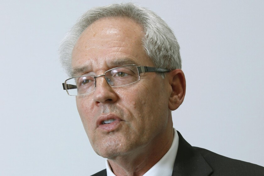 """FILE - In this Sept. 8, 2020, file photo, former Nissan Motor Co.'s executive Greg Kelly speaks during an interview in Tokyo. Kelly, on trial in Japan on charges related to former Nissan Chairman Carlos Ghosn's compensation, asserted his innocence Wednesday, May 12, 2021, testifying he had always acted legally and in the """"best interests of Nissan."""" (Kyodo News via AP, File)"""