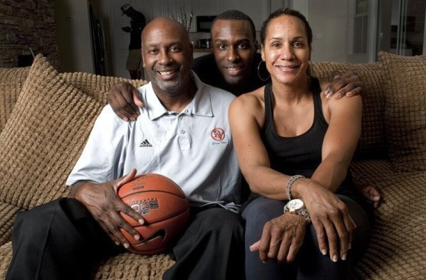 Former UCLA basketball star Shabazz Muhammad, center, poses for a photo with his parents in Las Vegas.