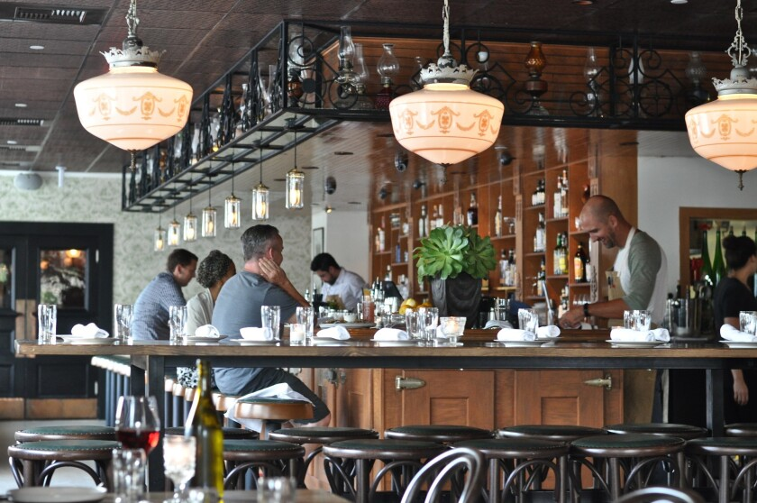 The interior of Hatchet Hall, the newish restaurant from chef Brian Dunsmoor in Culver City, is filled with mirrors and silver and taxidermy.