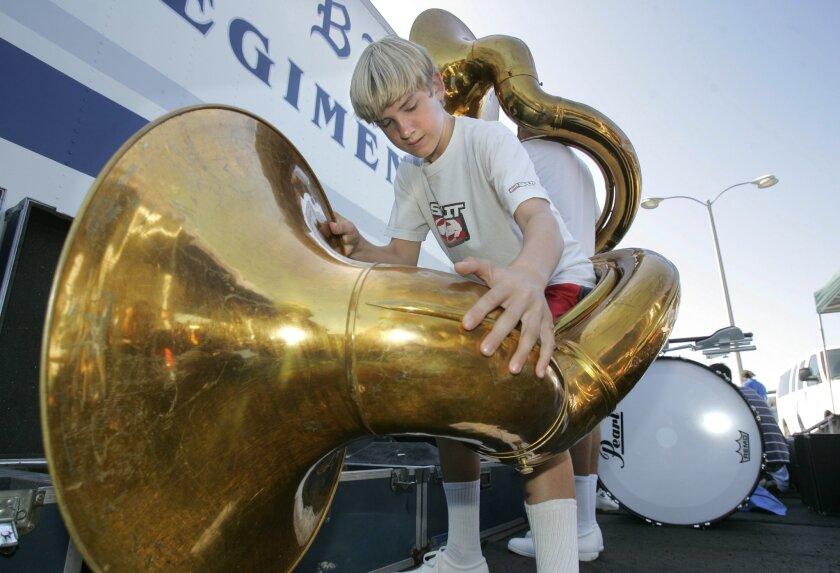 Rancho Bernardo High's Jake Gutkowski prepared his tuba yesterday for the tournament of bands. (Charlie Neuman / Union-Tribune)
