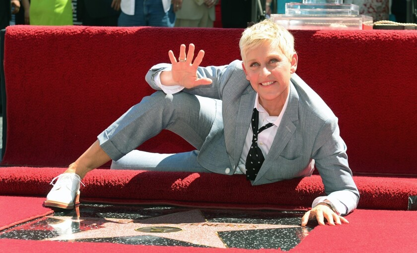 Ellen DeGeneres, seen here as her star is unveiled on Hollywood Boulevard last September, will host the Oscars for a second time, producers Craig Zadan and Neil Meron announced.