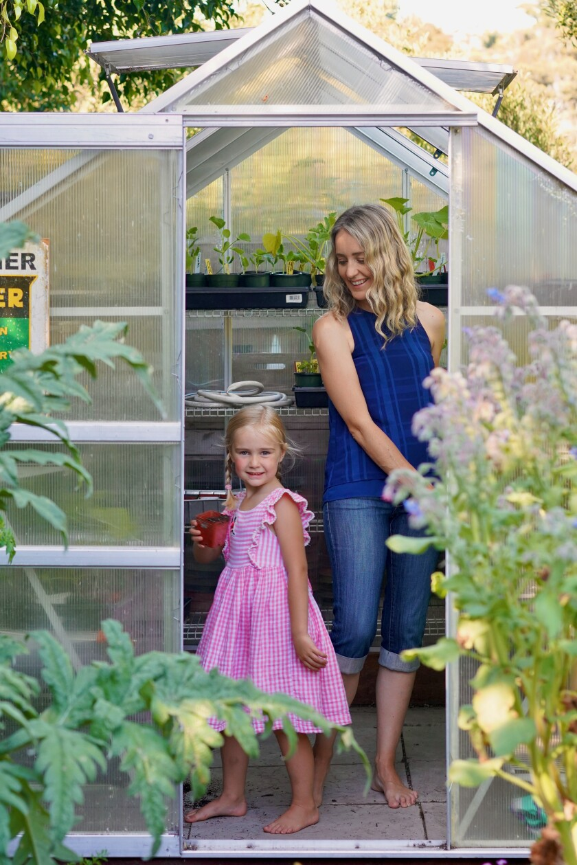 Jen Oliver's daughter Amelia, 5, helps pick the produce grown in their La Jolla backyard.