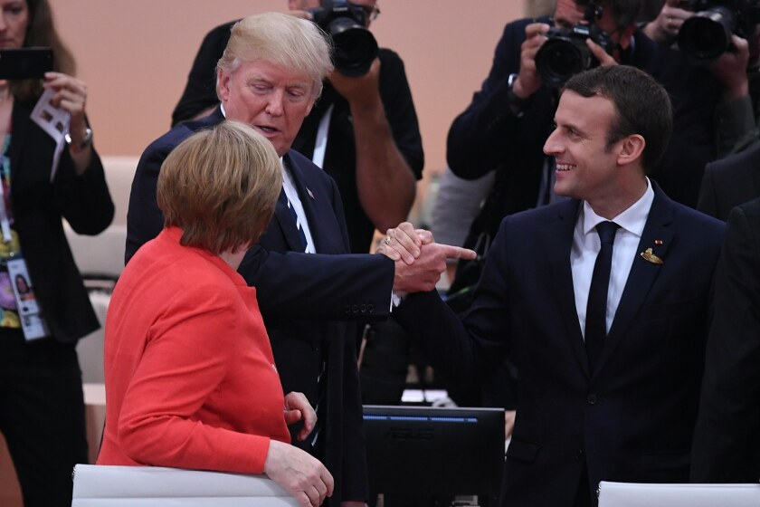Angela Merkel, Emmanuel Macron and Donald Trump at a Group of 20 summit in 2017. How can we solve global problems if nations hide behind defensive walls?