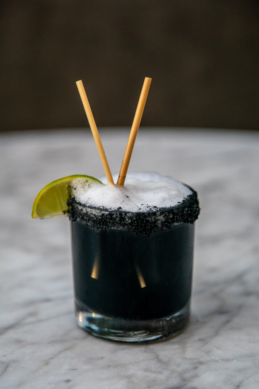 Openaire's Midnight Margarita is made with tequila, cointreau, lime and charcoal.