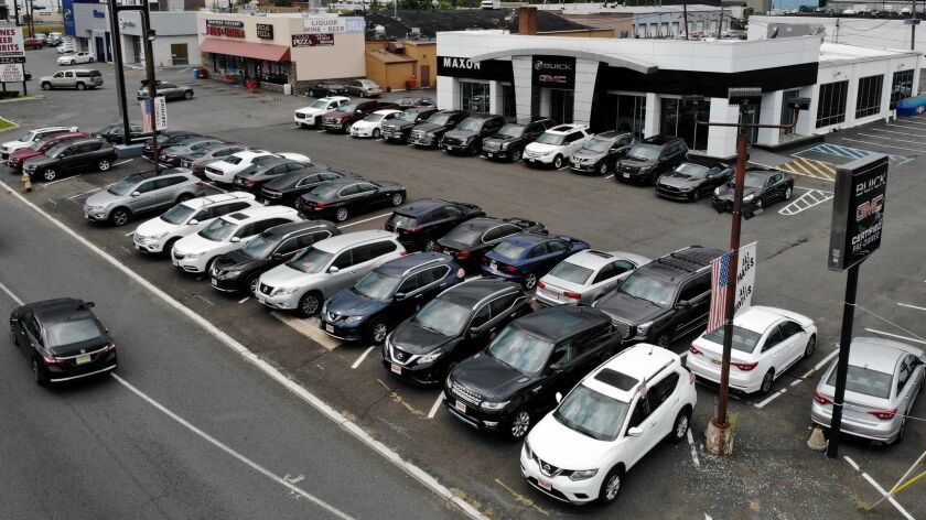 New vehicles are displayed for sale at a Buick GMC dealership in Union, N.J. Sales of new vehicles in the U.S. during 2018 exceeeded expectations.