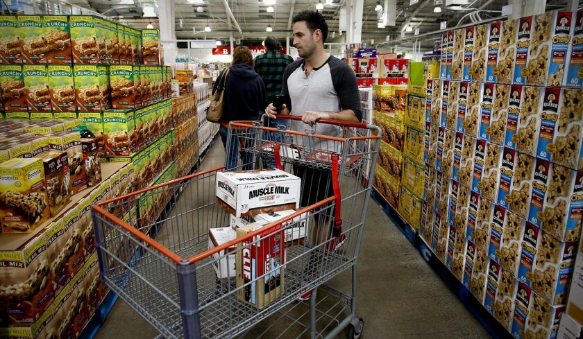 Andrew Lehr of downtown San Diego easily navigates the 6-foot-wide aisle and can reach over the 54-inch-high stacks of merchandise, measurements specified by Sol Price years ago.