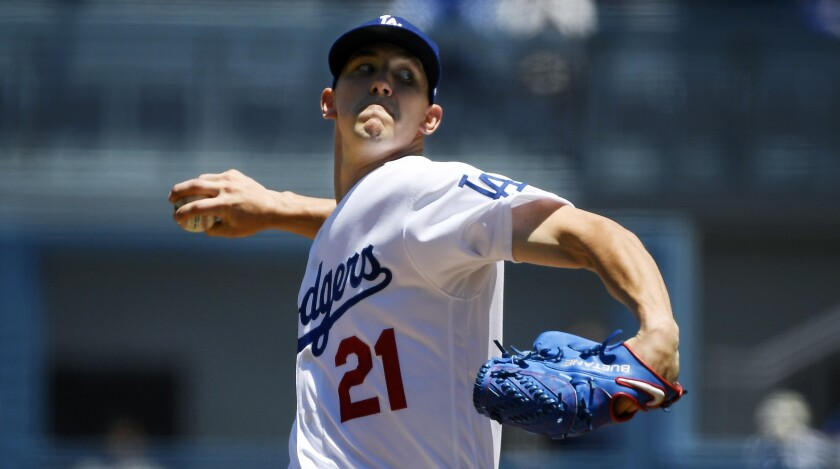 Dodgers starter Walker Buehler delivers during the first inning of the Dodgers' victory over the Miami Marlins at Dodger Stadium on Sunday.