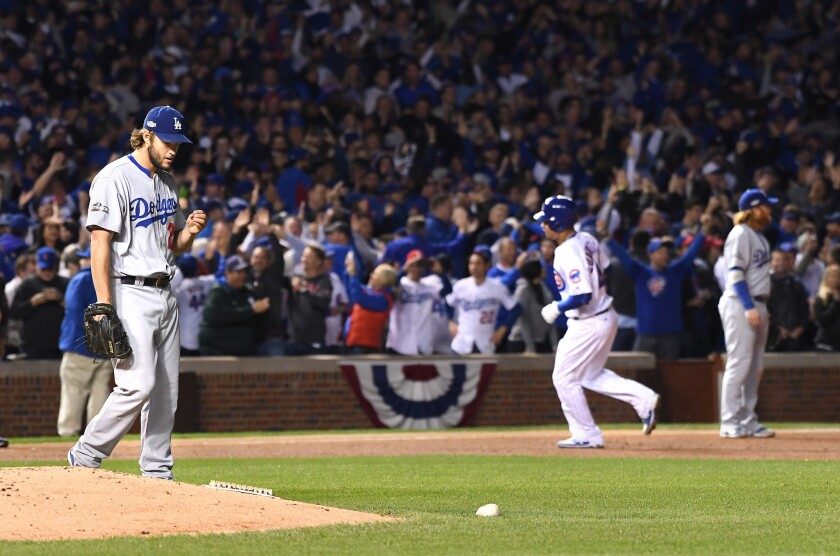 Dodgers pitcher Clayton Kershaw walks back to the mound as Cubs catcher Willson Contreras rounds the bases after his solo home run in the fourth inning of Game 6.