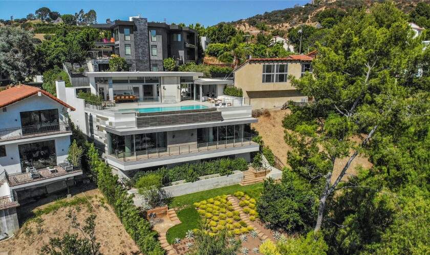 The three-story home wraps around a Zen garden and also includes a two-story subterranean garage.