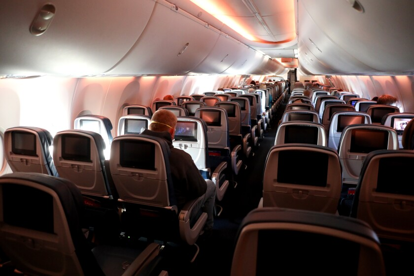 Passengers on a nearly empty plane