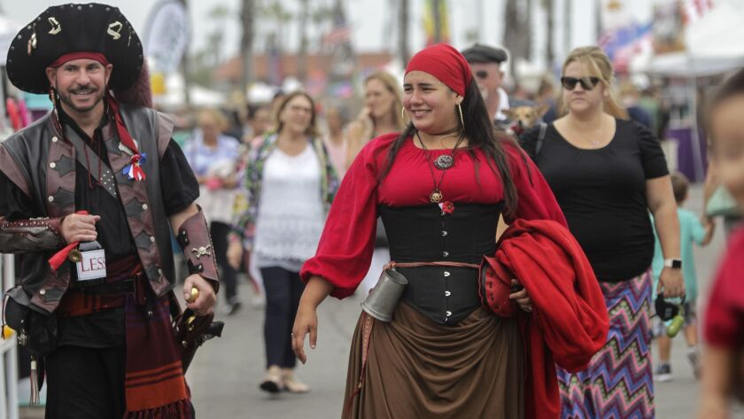 """Dressed in their swashbuckling costumes, Carlo """"Badger"""" Mazzurra, left, and Electra """"The GreeK"""