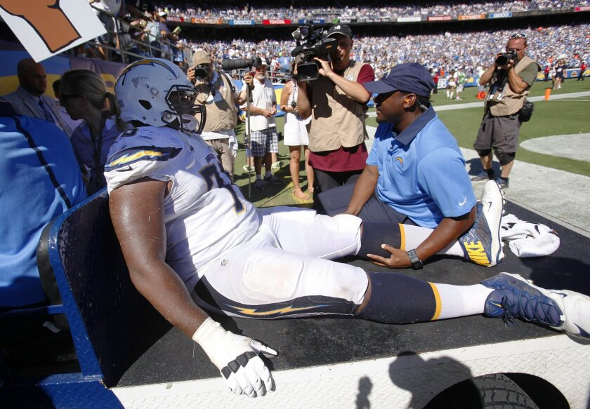 Chargers D.J. Fluker is taken off the field after getting injured against the Lions.