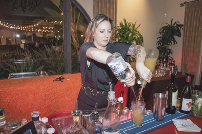 Barrista Tiffany Starr serves up drinks for 'To Dine For' event attendees.