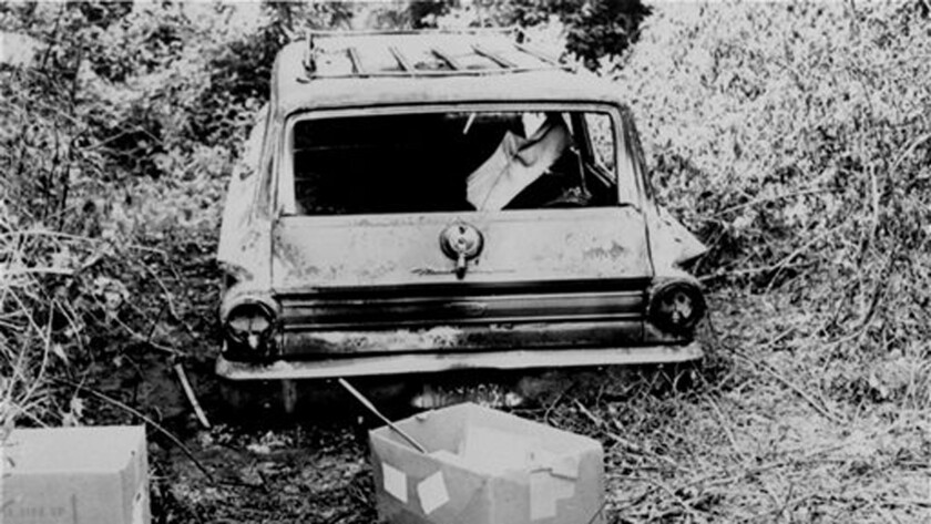 This June 24, 1964, photo shows the burned station wagon of Michael Schwerner, Andrew Goodman and James Chaney in a swampy area near Philadelphia, Miss. The bodies of the men were found later in an earthen dam.