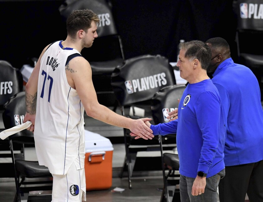 Dallas Mavericks owner Mark Cuban, right, shakes hands with Mavericks' Luka Doncic (77) after they were defeated by the Los Angeles Clippers during Game 7 of an NBA basketball first-round playoff series Sunday, June 6, 2021, in Los Angeles, Calif. (Keith Birmingham/The Orange County Register via AP)
