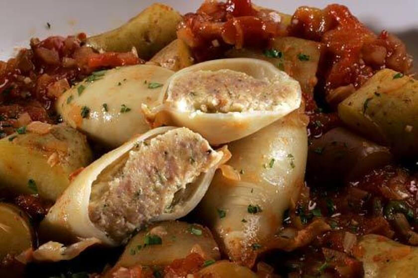 <b>A LITTLE SPICY: </b>Filled with Italian sausage, squid are braised to silken perfection in a caper-spiked tomato sauce.