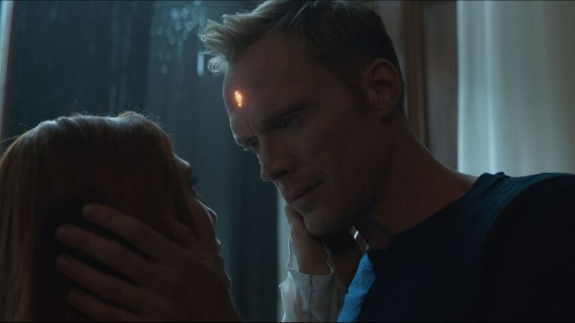 "(L-R) - Scarlet Witch/Wanda Maximoff (Lizzie Olsen) and Vision (Paul Bettany) in a scene from ""Mar"
