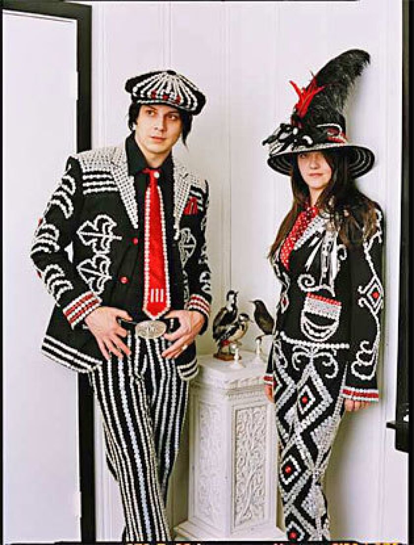 St. John wound up handstitching 13,000 buttons onto Jack and Meg White's suits.