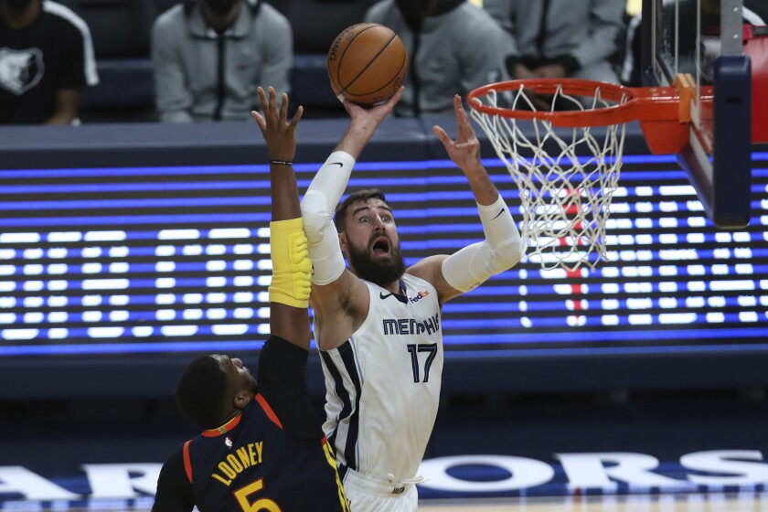 FILE - In this May 21, 2021, file photo, Memphis Grizzlies' Jonas Valanciunas (17) shoots against the Golden State Warriors' Kevon Looney (5) during the second half of an NBA basketball Western Conference play-in game in San Francisco. A person familiar with the situation says the Grizzlies have agreed to trade Valanciunas to the New Orleans Pelicans in exchange for center Steven Adams, guard Eric Bledsoe and an exchange of first-round choices in this week's draft. The person spoke to The Associated Press on condition of anonymity on Monday, July 26, 2021, because no trade can become official until Aug. 6. (AP Photo/Jed Jacobsohn, File)