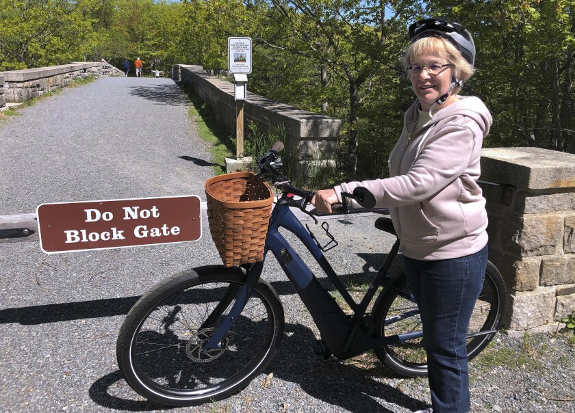 Janice Goodwin and an electric bicycle at Acadia National Park