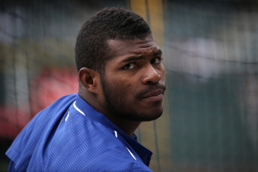 Dodgers outfielder Yasiel Puig (66) takes batting practice prior to facing the Colorado Rockies at Coors Field on April 23.