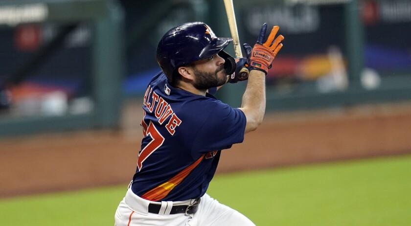 Houston Astros second baseman Jose Altuve bats during an intrasquad game.