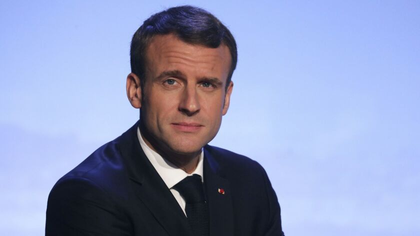 France's President Emmanuel Macron delivers a speech at the Internet Governance Forum organized at t