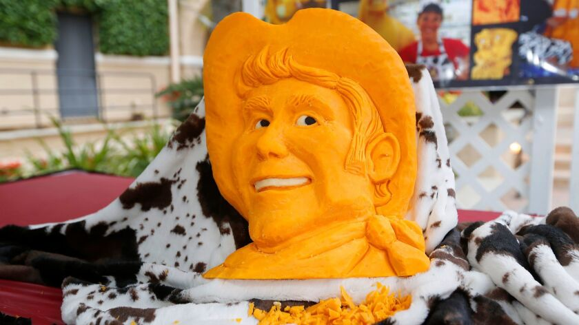 Sarah Kaufmann, of Coronado, known as The Cheese Lady carved a cowboy out of a block of cheddar chee