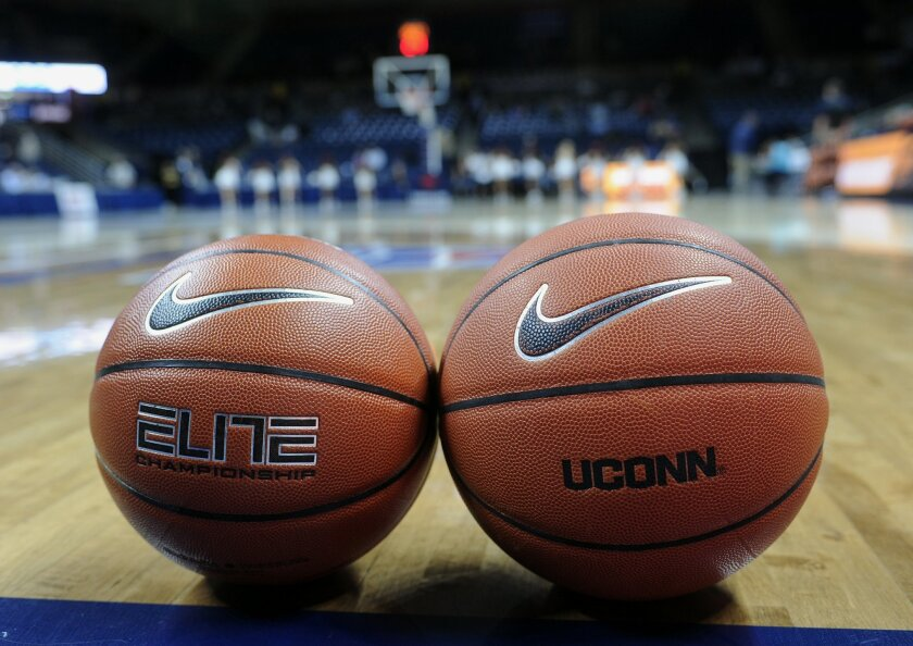 A women's college basketball, left, and men's college basketball are displayed before an NCAA college exhibition basketball game between Connecticut and Vanguard, Sunday, Nov. 8, 2015, in Storrs, Conn. UConn will be using some experimental rules, including a men's basketball, a 24-second shot clock