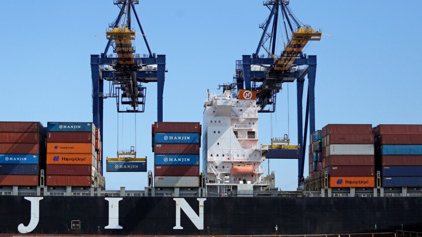 A Hanjin container ship is unloaded at the Port of Los Angeles on Sept. 13 despite the company's ongoing bankruptcy case.