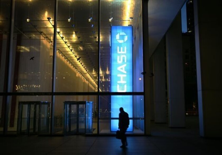 "FILE - In this Oct. 10, 2008 file photo, a man walks into a JP Morgan Chase & Co. building in New York's financial district. Since the financial crisis, JPMorgan Chase has a long list of legal challenges beyond the $6 billion trading loss known as the ""London Whale"" . (AP Photo/Mark Lennihan, file)"