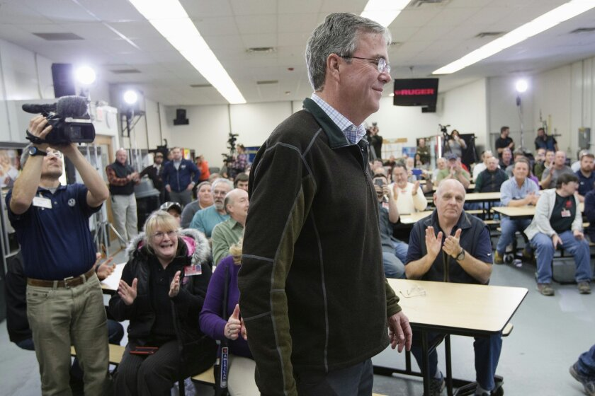 Attendees applaud as Republican presidential candidate, former Florida Gov. Jeb Bush arrives to speak during a campaign stop at Sturm, Ruger & Co. Inc., Thursday, Jan. 21, 2016, in Newport, N.H. (AP Photo/John Minchillo)