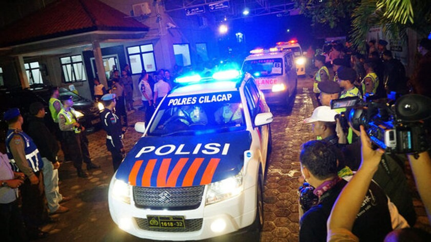 An Indonesian police car leads ambulances carrying bodies of prisoners as they arrive in Cilacap, Central Java, from Nusakambangan Island prison complex after their execution.
