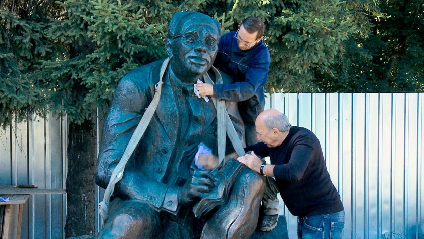 """Georgy Frangulyan and an assistant work on a sculpture of Isaac Babel in the documentary """"Finding Babel."""""""