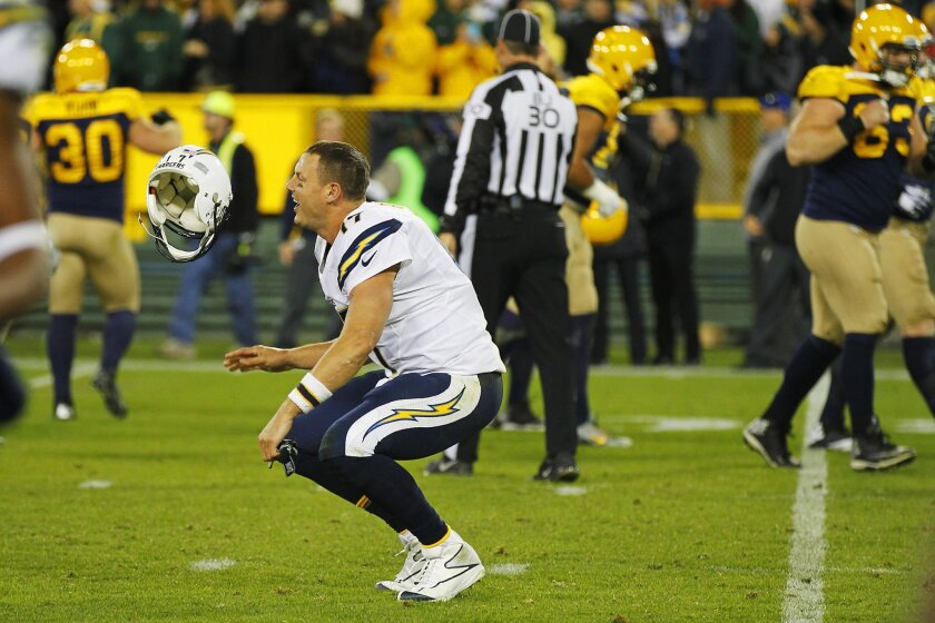 Philip Rivers flips his helmet at the end of Sunday's loss to the Packers. He and the Chargers know a new season starts Sunday with an AFC West game against the Oakland Raiders.