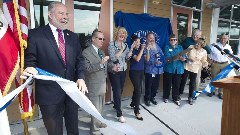 Orange Coast College President Dennis Harkins, left, celebrates with other local officials during a ribbon-cutting ceremony for the OCC Recycling Center in September 2017.