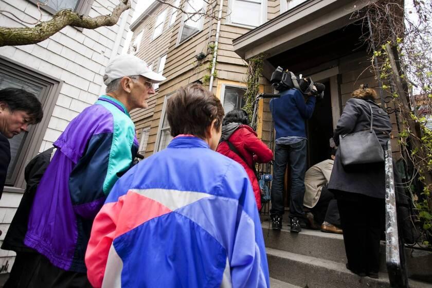 People visit the Tsarnaev home in Cambridge, Mass. Brothers Tamerlan and Dzhokhar Tsarnaev are suspected in the Boston Marathon bombings.