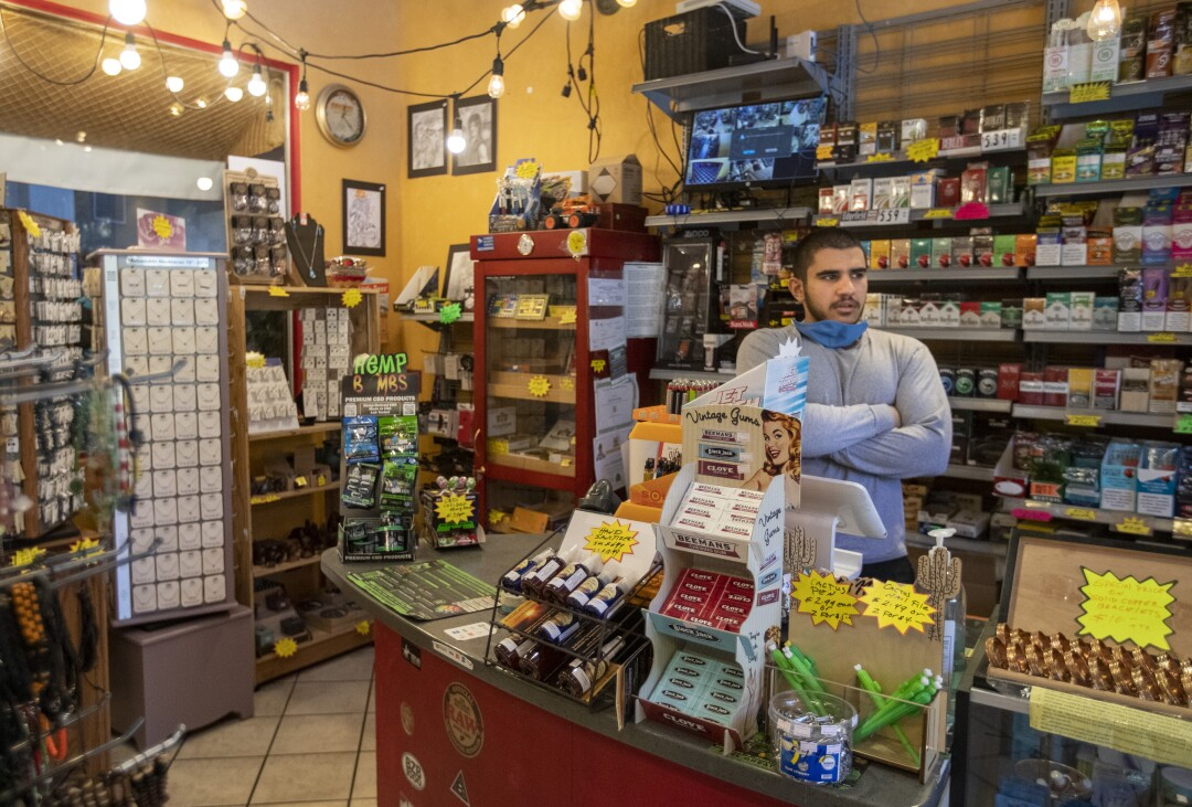 Hassan Sowid waits for customers at Mel's Bisbee Bodega, which is owned by his uncle.
