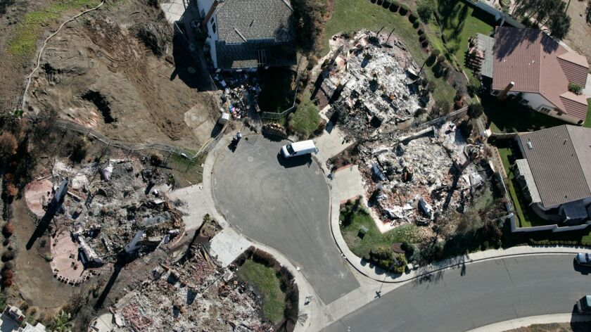The 2007 Witch Fire destroyed five of the six homes on this Rancho Bernardo cul-–de-–sac. San Diego Gas and Electric says ratepayers should cover most of the fire's cost.
