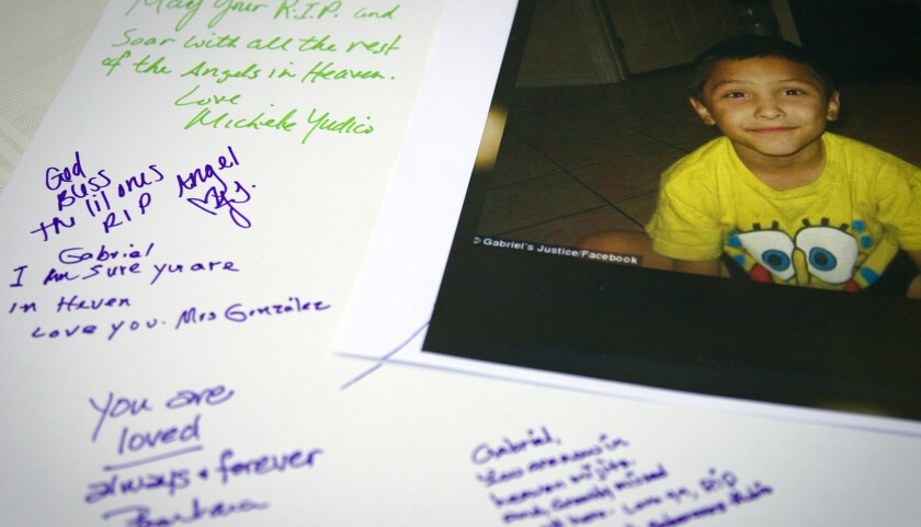 Tributes are written on a poster board during a memorial service last year for Gabriel Fernandez, 8, a Palmdale boy who was allegedly beat to death by his mother's boyfriend.