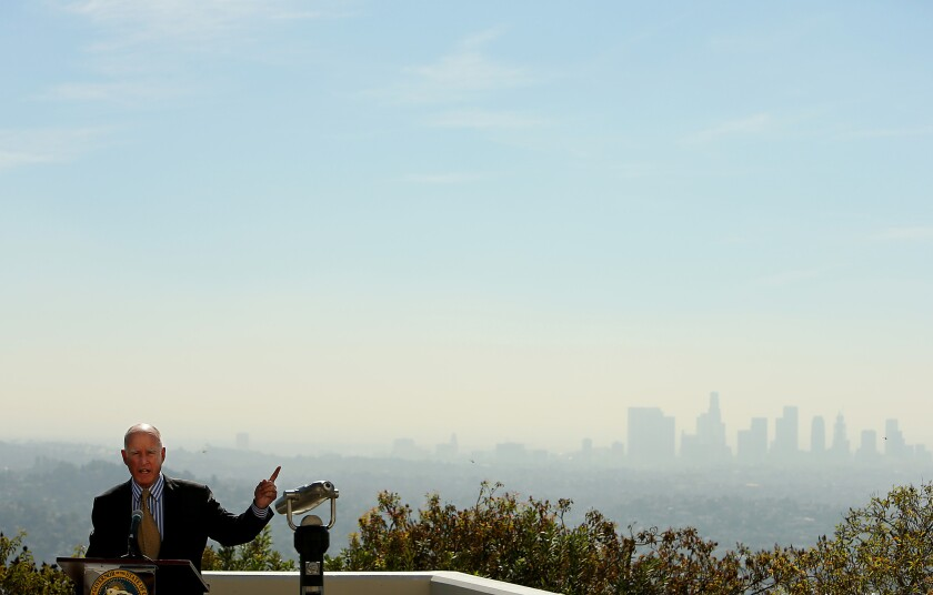 Gov. Jerry Brown, shown at the Griffith Observatory last year, signed new climate legislation in a Los Angeles park on Thursday.