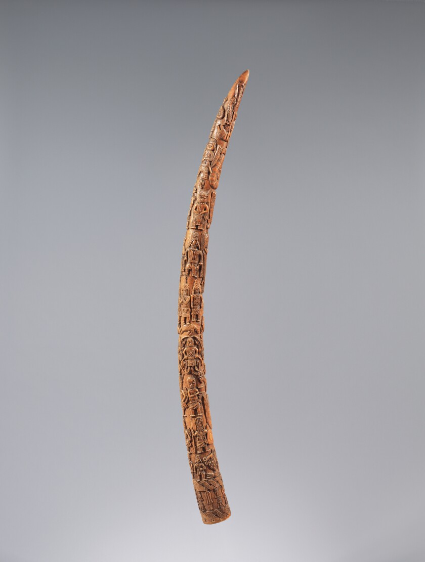A tusk with carvings all along its length