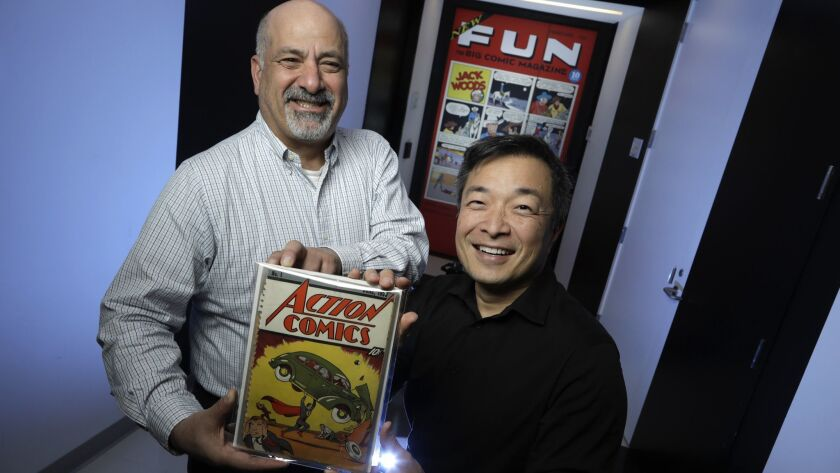 BURBANK, CALIF. -- MARCH 21, 2018: Co-publishers of DC Comics, Dan DiDio (left) and Jim Lee, holdin