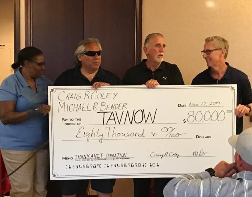 Thank a Vet President Jesse Acosta, second from left, accepts a check for $80,000 from donor Craig Coley, second from right, and his friend Mike Bender, far right, at a fundraising event April 27 at Pechanga Resort Casino in Temecula.