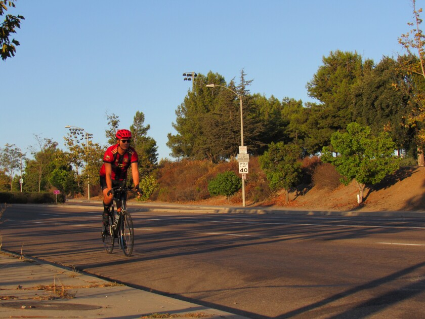 A cyclist heads west down Mast Boulevard in Santee. The street is among three in Santee now part of United States Bike Route 90.