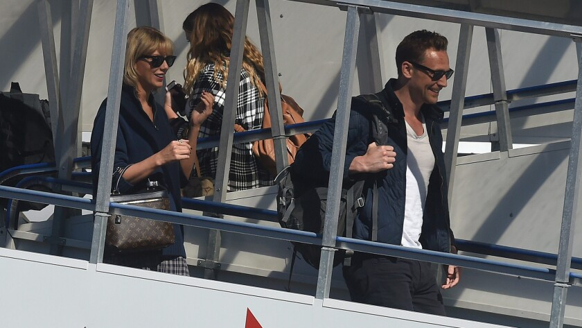 Taylor Swift and Tom Hiddleston arrive at Gold Coast Airport in Queensland, Australia, on July 8.