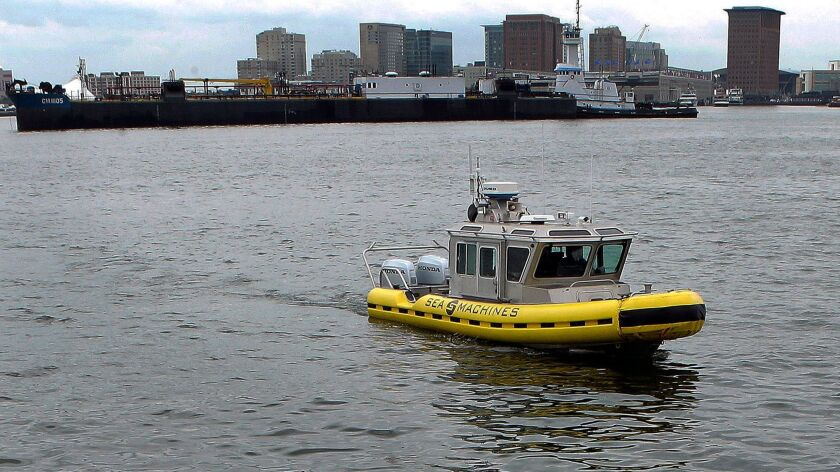 In this Tuesday, Aug. 15, 2017 photo, a boat capable of autonomous navigation makes its way around B