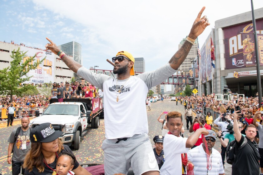 LeBron James celebrates the Cavaliers' championship with the city of Cleveland.